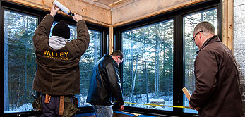 photo of ian lloyd and jeff jessup measuring a window
