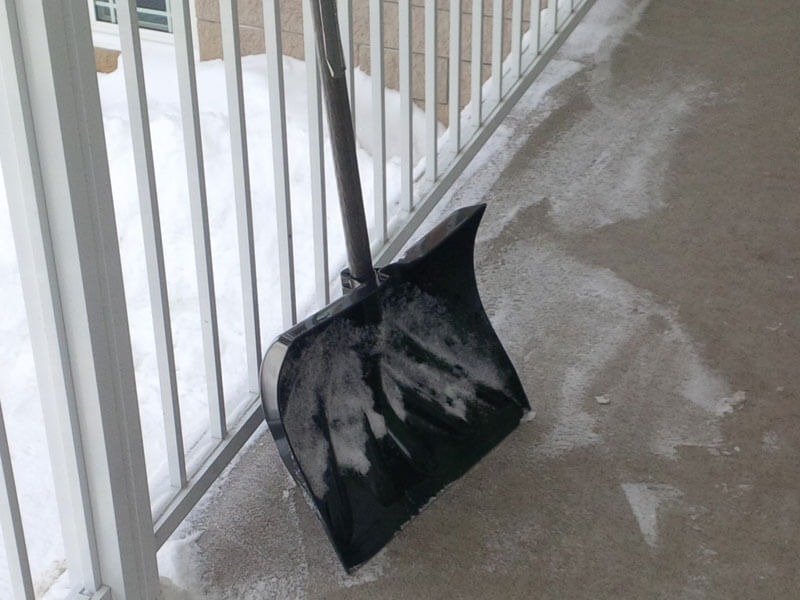 photo of plastic shovel leaning against railing on duradek