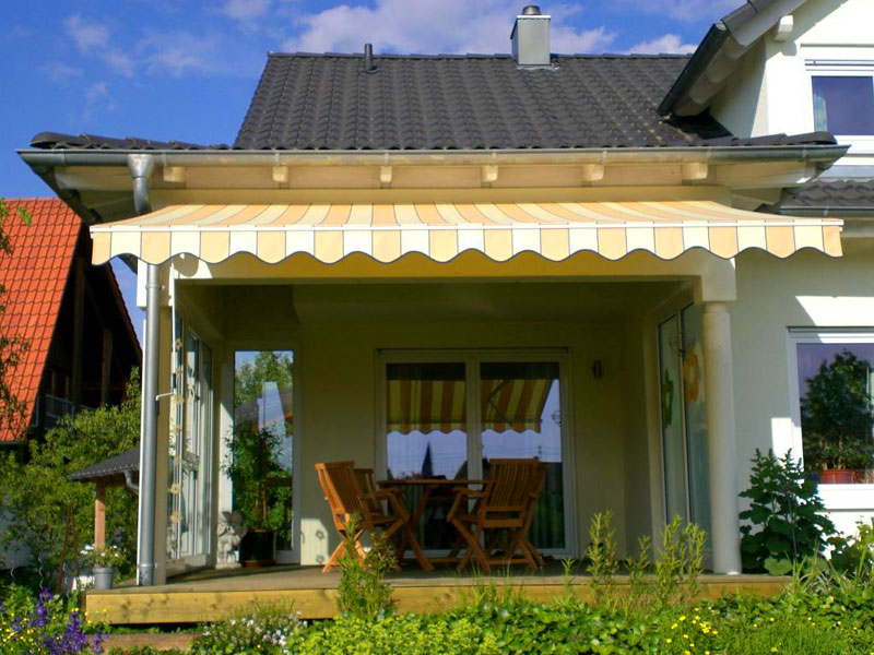 photo of retractable awning over back porch of county home