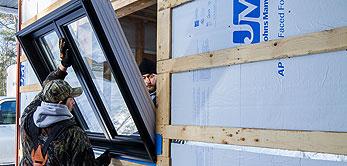 photo of two men installing a window